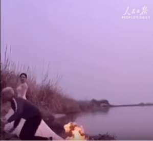 Bride Lets Photographer Set Her Wedding Gown On Fire In Order To Take Pictures....